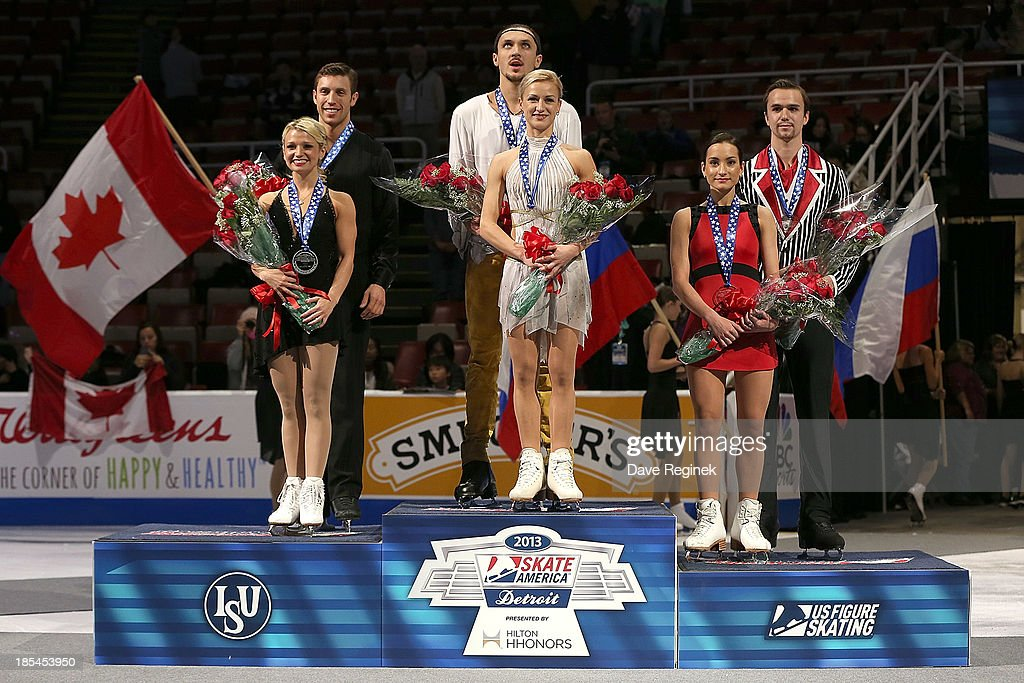 Medal winners of the pairs free skate are from L to R Silver, Kristen Moore-Towers and Dylan Moscovitch of Canada Gold, Tatiana Volosozhar and Maxim Trankov of Russia and Bronze, Ksenia Stolbova and Fedor Klimov of Russia during day three at Skate America at Joe Louis Arena on October 20, 2013 in Detroit, Michigan.