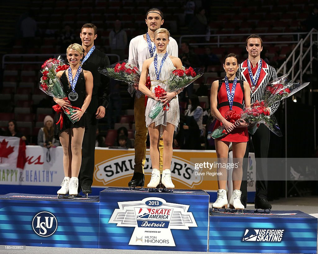 Medal winners of the pairs free skate are from L to R Silver, Kristen Moore-Towers and Dylan Moscovitch of Canada Gold, <a gi-track='captionPersonalityLinkClicked' href=/galleries/search?phrase=Tatiana+Volosozhar&family=editorial&specificpeople=798077 ng-click='$event.stopPropagation()'>Tatiana Volosozhar</a> and <a gi-track='captionPersonalityLinkClicked' href=/galleries/search?phrase=Maxim+Trankov&family=editorial&specificpeople=798054 ng-click='$event.stopPropagation()'>Maxim Trankov</a> of Russia and Bronze, Ksenia Stolbova and Fedor Klimov of Russia during day three at Skate America at Joe Louis Arena on October 20, 2013 in Detroit, Michigan.