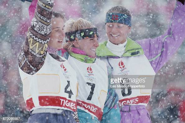 Medal winners of the Women's freestyle skiing moguls event at the 1992 Winter Olympics line up together on the podium from left to right silver medal...