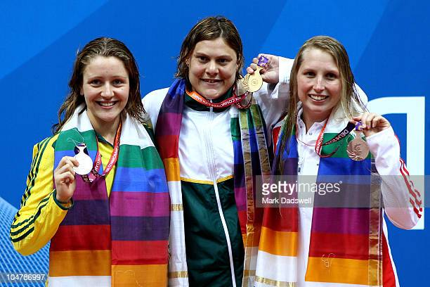 Medalists Annabelle Williams of Australia Natalie Du Toit of South Africa and Stephanie Millward of England pose during the medal ceremony for the...