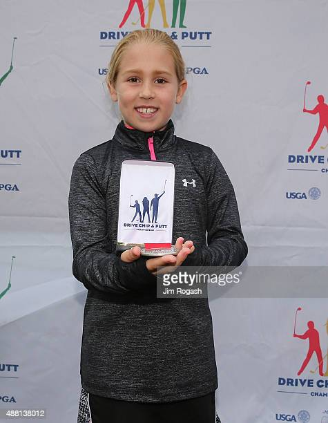 Medalists Carys Jenessy poses with her medal in the Girls 79 group during the 2015 Drive Chip and Putt Championship at The Country Club on September...