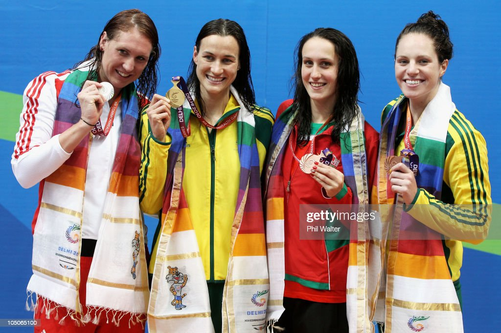 Medalists Gemma Spofforth of England (Silver), Sophie Edington of Australia (Gold), Georgia Davies of Wales and Emily Seebohm of Australia (Bronze) pose during the medal ceremony for the Women's 50m Backstroke Final at Dr. S.P. Mukherjee Aquatics Complex during day five of the Delhi 2010 Commonwealth Games on October 8, 2010 in Delhi, India.