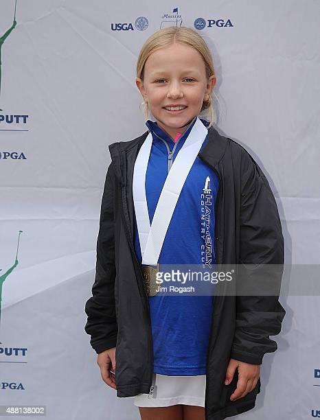Medalists Jillian Johnson poses with her medal in the Girls 79 group during the 2015 Drive Chip and Putt Championship at The Country Club on...