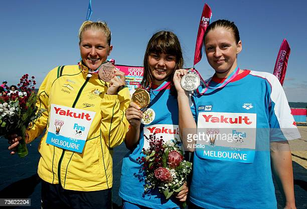 Medalists Kate BrookesPeterson of Australia Larisa Ilchenko of Russia and Ekaterina Seliverstova of Russia pose for photographers after competing in...