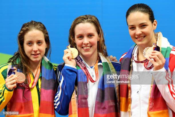 Medalists Samantha Hamill of Australia Hannah Miley of Scotland and KeriAnn Payne of England pose during the medal ceremony for the Women's 400m...