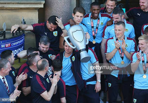 A medalless Joey Barton celebrates with an inflatable trophy as Sky Bet Champions Burnley are presented with the Championship trophy at the Town Hall...