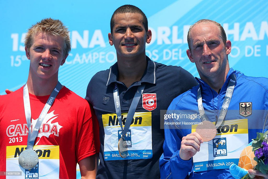 Medallists Eric Hedlin of Canada (silver), <a gi-track='captionPersonalityLinkClicked' href=/galleries/search?phrase=Oussama+Mellouli&family=editorial&specificpeople=2297983 ng-click='$event.stopPropagation()'>Oussama Mellouli</a> of Tunisia (gold) and Thomas Luhr of Germany (bronze) pose with their medals after the Open Water Swimming Men's 5k race on day one of the 15th FINA World Championships at Moll de la Fusta on July 20, 2013 in Barcelona, Spain.