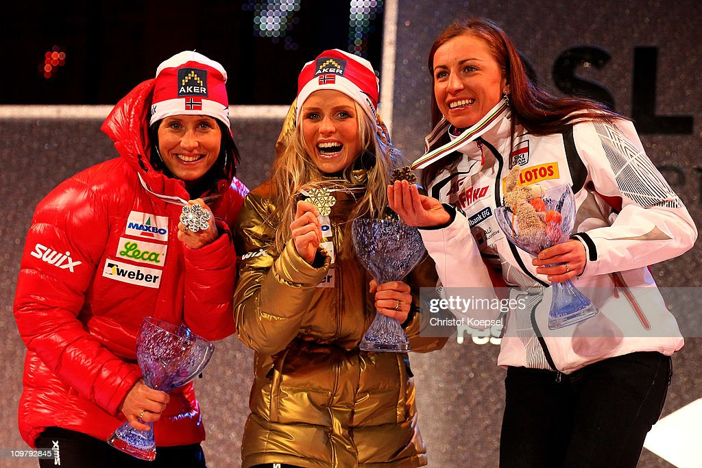 Medallists Marit Bjoergen (silver) of Norway, <a gi-track='captionPersonalityLinkClicked' href=/galleries/search?phrase=Therese+Johaug&family=editorial&specificpeople=4176080 ng-click='$event.stopPropagation()'>Therese Johaug</a> (gold) of Norway and Justyna Kowalczyk (bronze) of Poland celebrate with the medals won in the Ladies Cross Country 30km Mass Start race during the FIS Nordic World Ski Championships at Holmenkollen on March 5, 2011 in Oslo, Norway.