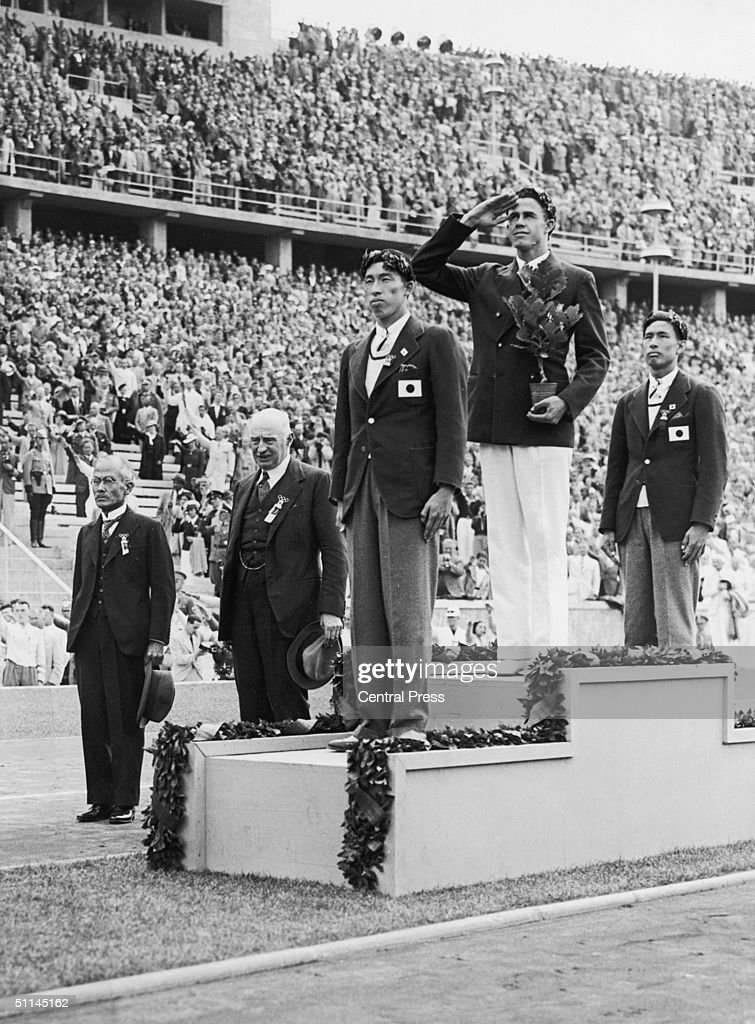 Medallists on the podium after the men's pole vault event at the Berlin Olympics, 6th August 1936. The gold medallist is Earle Meadows of the USA, silver went to Shuhei Nishida of Japan and bronze was won by Sueo Oe, also of Japan.