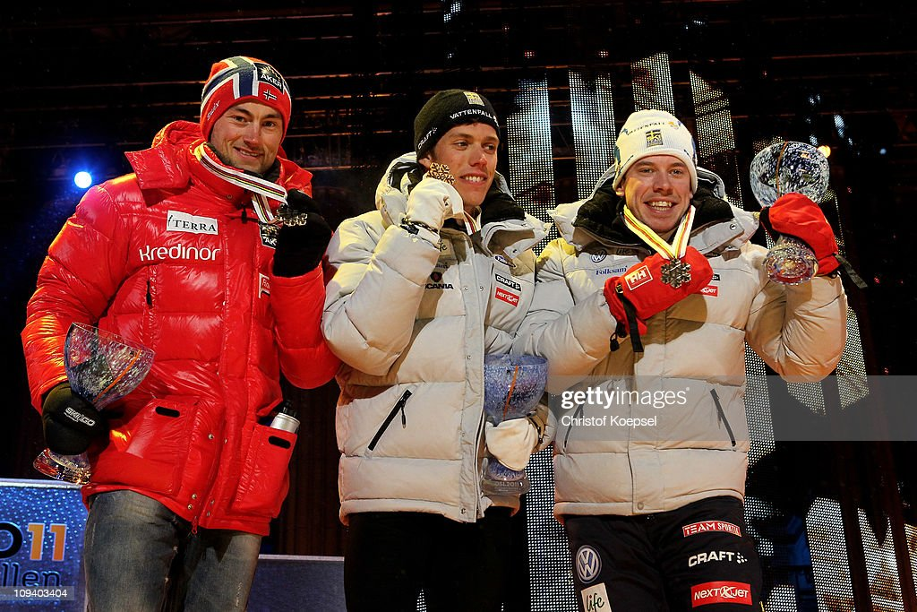 Medallists <a gi-track='captionPersonalityLinkClicked' href=/galleries/search?phrase=Petter+Northug&family=editorial&specificpeople=800847 ng-click='$event.stopPropagation()'>Petter Northug</a> (silver) of Norway, <a gi-track='captionPersonalityLinkClicked' href=/galleries/search?phrase=Marcus+Hellner&family=editorial&specificpeople=4046940 ng-click='$event.stopPropagation()'>Marcus Hellner</a> (gold) of Sweden and <a gi-track='captionPersonalityLinkClicked' href=/galleries/search?phrase=Emil+Joensson&family=editorial&specificpeople=4045550 ng-click='$event.stopPropagation()'>Emil Joensson</a> (bronze) of Sweden celebrate with the medals won in the Men's Cross Country Sprint race during the FIS Nordic World Ski Championship at Holmenkollen on February 24, 2011 in Oslo, Norway.