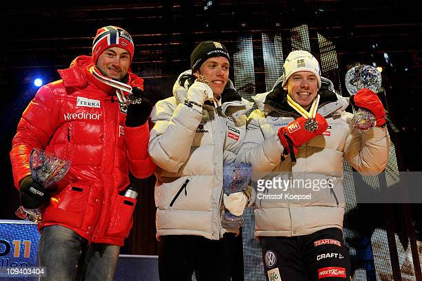 Medallists Petter Northug of Norway Marcus Hellner of Sweden and Emil Joensson of Sweden celebrate with the medals won in the Men's Cross Country...