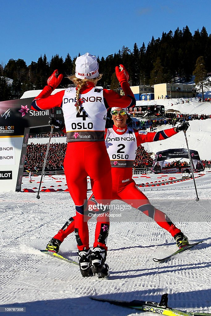 Medallists Therese Johaug (gold) of Norway and Marit Bjoergen (silver) of Norway celebrate after crossing the finish line in the Ladies Cross Country 30km Mass Start race during the FIS Nordic World Ski Championships at Holmenkollen on March 5, 2011 in Oslo, Norway.