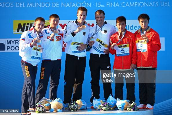 Medallists Victor Minibaev and Artem Chesakov of Russia Patrick Hausding and Sascha Klein of Germany and Zhang Yanguan and Cao Yuan of China pose on...