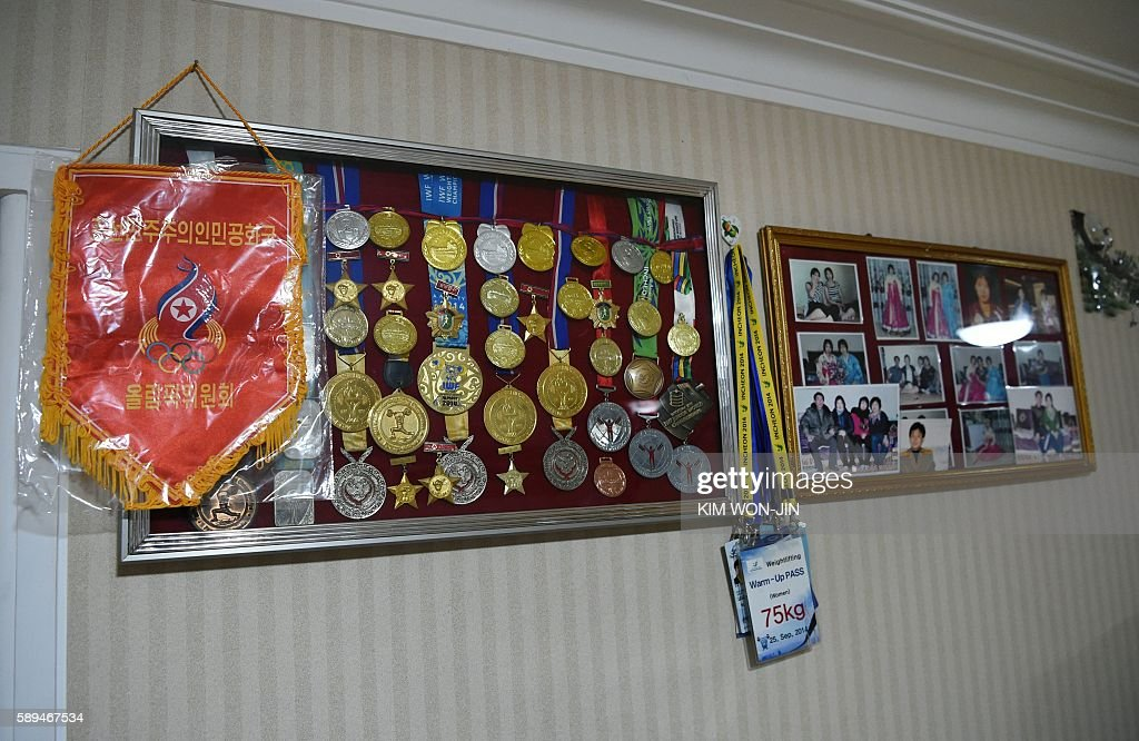Medals and a congratulatory banner from North Korea's Olypmic Committee as well as other national and international awards and photos are pictured on...
