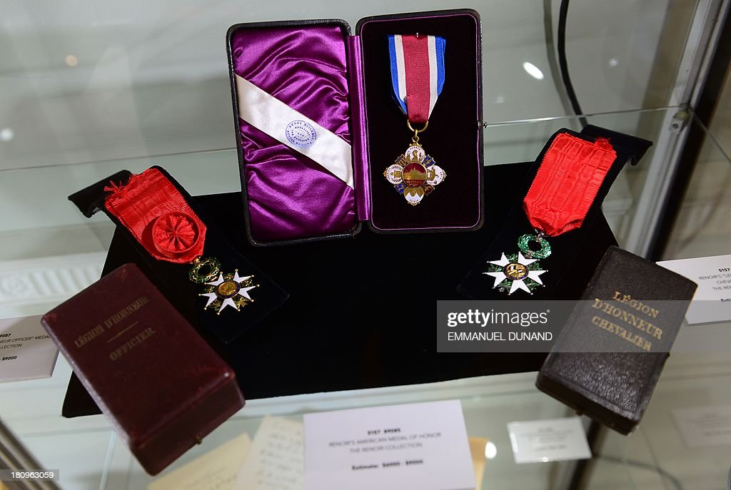 Medals which belonged to late French artist Pierre-August Renoir are on display at Heritage Auctions in New York, September 18, 2013.The single-largest archive of Renoir's personally-owned object, sculptures and letters are set to go on auction on September 19, 2013. AFP PHOTO/Emmanuel Dunand