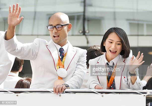 Medalwinning Paralympics athletes Atsushi Yamamoto and Sae Tsuji take part in a parade of the Rio Olympics and Paralympics medalists in Tokyo on Oct...