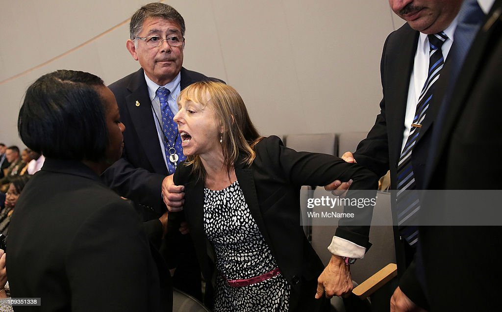 Medea Benjamin an activist from the organization called Code Pink shouts at US President Barack Obama while he speaks at the National Defense...