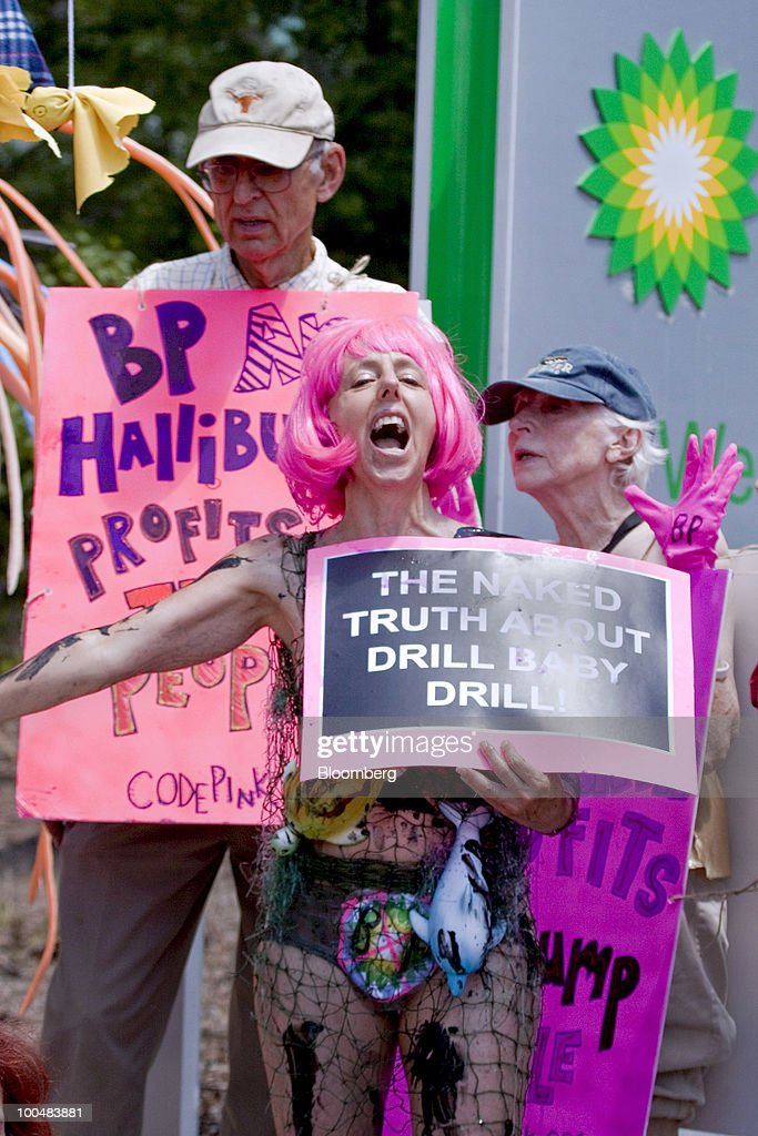 Medea Benjamin, co-founder of the Code Pink anti-war group, center, leads a demonstration outside the U.S. headquarters of BP Plc in Houston, Texas, U.S., on Monday, May 24, 2010. BP Plc will try in two days to plug an oil leak off Louisiana's coast by pumping heavy drilling fluids into the Macondo well, which was damaged when the Deepwater Horizon drilling rig exploded on April 20. BP said it's committing as much as $500 million on a research program studying the impact of the incident on the marine and shoreline environment of the Gulf of Mexico. Photographer: F. Carter Smith/Bloomberg via Getty Images
