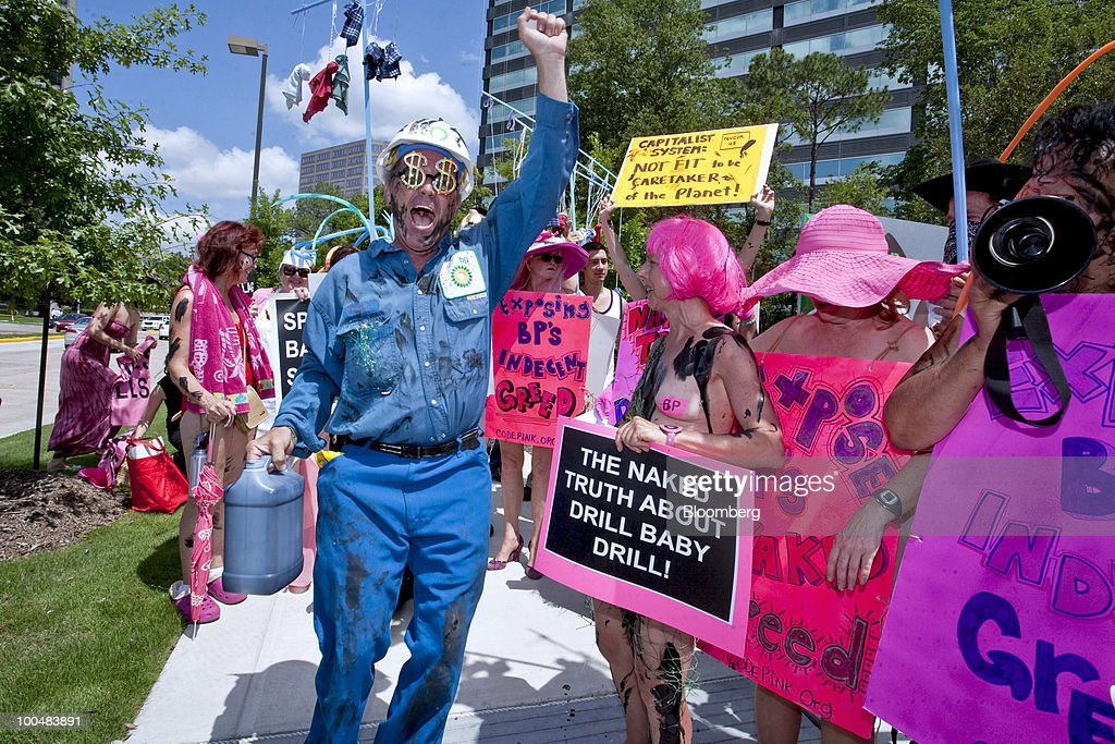 Medea Benjamin, co-founder of the Code Pink anti-war group, center right, leads a demonstration outside the U.S. headquarters of BP Plc in Houston, Texas, U.S., on Monday, May 24, 2010. BP Plc will try in two days to plug an oil leak off Louisiana's coast by pumping heavy drilling fluids into the Macondo well, which was damaged when the Deepwater Horizon drilling rig exploded on April 20. BP said it's committing as much as $500 million on a research program studying the impact of the incident on the marine and shoreline environment of the Gulf of Mexico. Photographer: F. Carter Smith/Bloomberg via Getty Images
