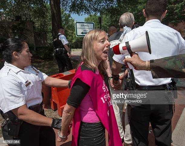 Medea Benjamin of Code Pink manages to use a bullhorn while handcuffed after being arrested during a vigil of civil disobedience and conducting a...