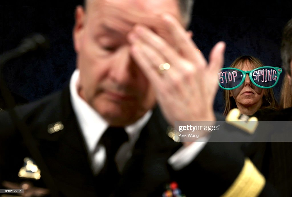 Medea Benjamin of CodePink protests as Director of the National Security Agency Gen Keith Alexander waits for the beginning of a hearing before the...