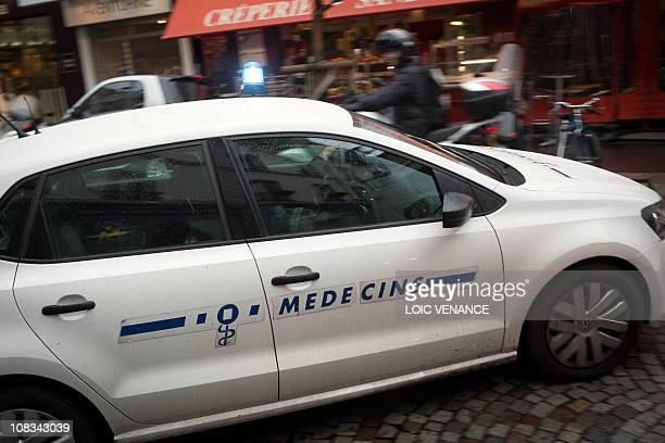 A 'SOS Medecins' doctor drives his car on January 12 2011 in Paris AFP PHOTO LOIC VENANCE