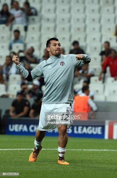 Medel of Besiktas greets the supporters of Besiktas ahead of UEFA Champions League Group G match between Besiktas and Leipzig at Vodafone Park in...