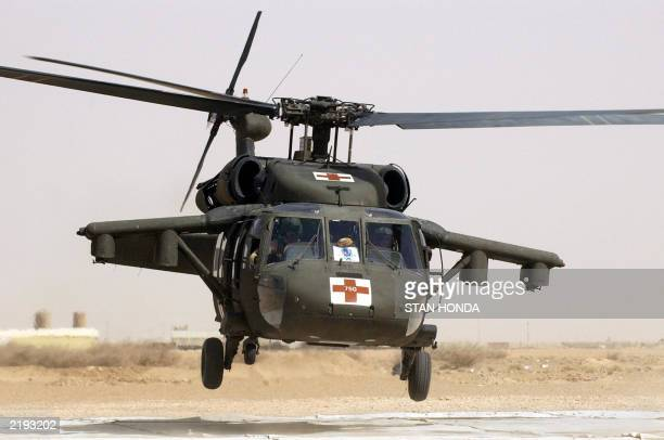 A medevac helicopter lifts off from a landing pad 15 July from the 28th Combat Support Hospital 25 km south west of Baghdad The largest ongoing US...