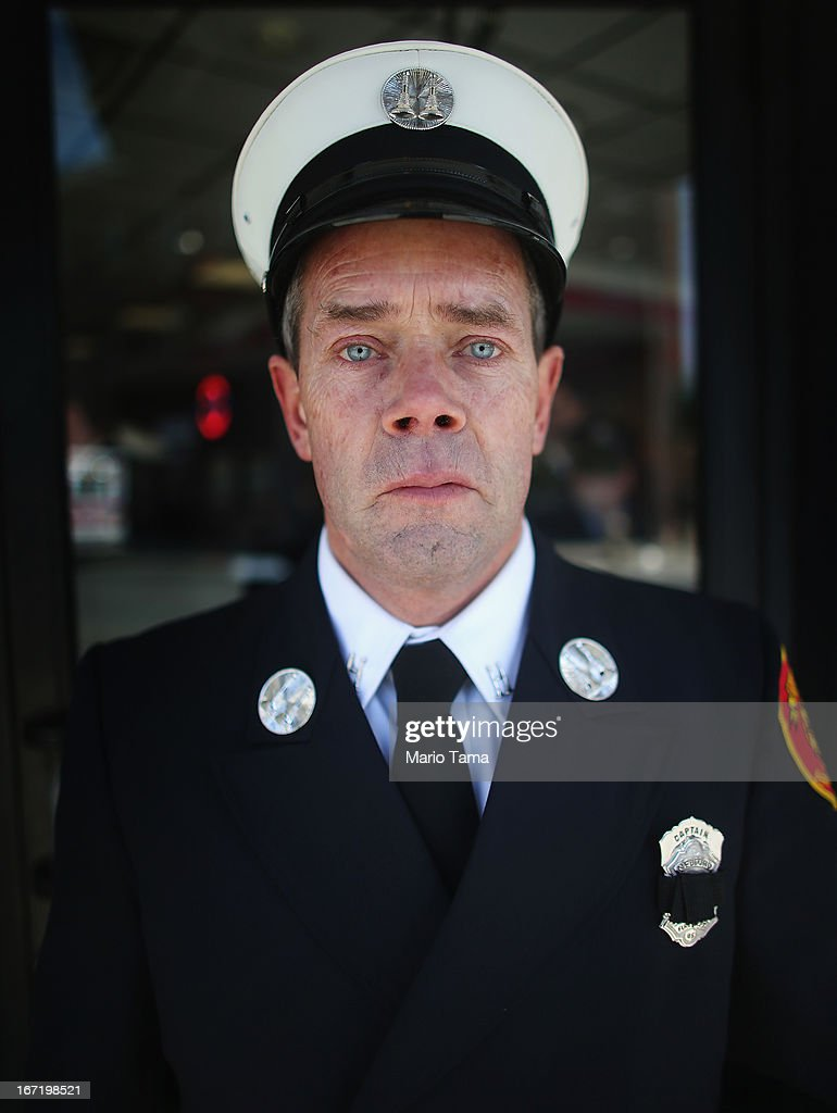 Medford Fire Department Captain Tom Brennan poses after representing at the funeral for 29-year-old Krystle Campbell, who was one of three people killed in the Boston Marathon bombings, on April 22, 2013 in Medford, Massachusetts. The 29-year-old restaurant manager was raised in Medford. Massachusetts Gov. Deval Patrick has asked residents to observe a moment of silence at the time of the first explosion at 2:50 p.m. this afternoon.