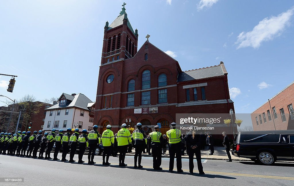 Medford Police line the street as the hearse arrives at St. Joseph Catholic Church for the funeral of Krystle Campbell, a victim of the Boston Marathon bombing, on April 22, 2013 in Medford, Massachusetts. A manhunt ended for Dzhokhar A. Tsarnaev, 19, a suspect in the Boston Marathon bombing after he was apprehended on a boat parked on a residential property in Watertown, Massachusetts. His brother Tamerlan Tsarnaev, 26, the other suspect, was shot and killed after a car chase and shootout with police. The bombing, on April 15 at the finish line of the marathon, killed three people and wounded at least 170.