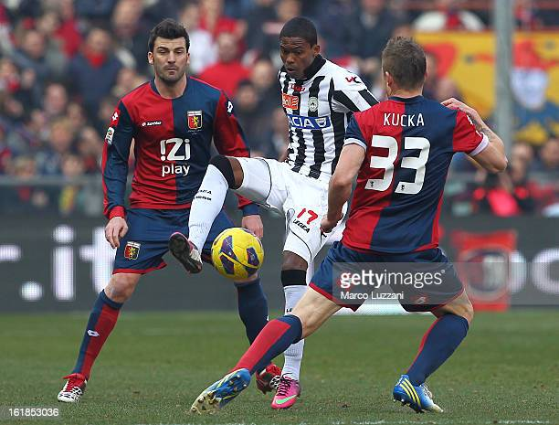 Medhi Amine Benatia El Mouttaqu of Udinese Calcio competes for the ball with Juraj Kucka and Cesare Bovo of Genoa CFC during the Serie A match...