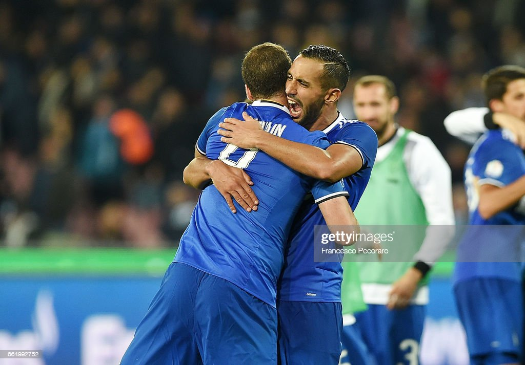 Medhi Benatia and Gonzalo Higuain of Juventus FC celebrate after the TIM Cup match between SSC Napoli and Juventus FC at Stadio San Paolo on April 5, 2017 in Naples, Italy.