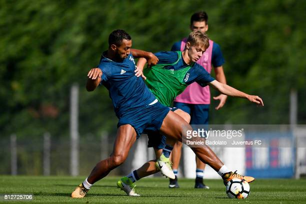 Medhi Benatia and Hans Nicolussi Caviglia of Juventus during the afternoon training session on July 11 2017 in Vinovo Italy