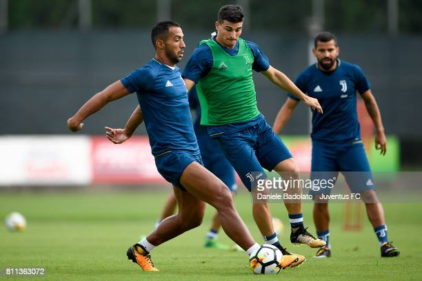 Medhi Benatia and Riccardo Orsolini of Juventus during the afternoon training session on July 9 2017 in Vinovo Italy