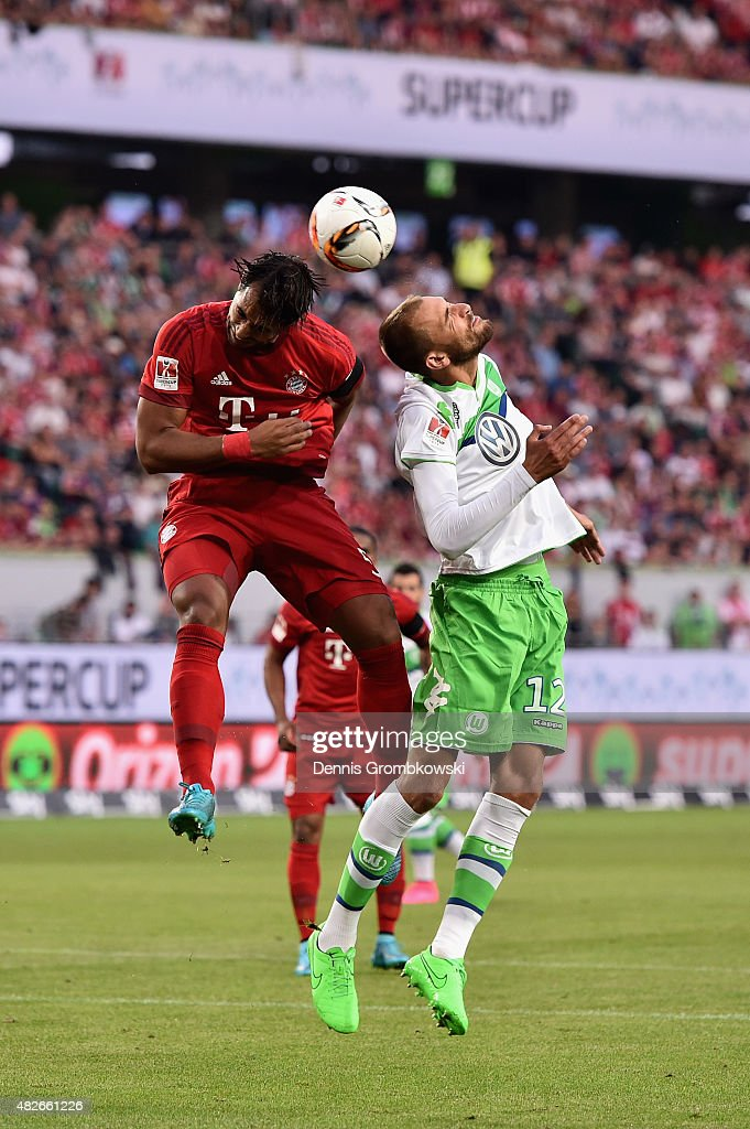 Medhi Benatia of FC Bayern Muenchen and Bas Dost of VfL Wolfsburg go up for a header during the DFL Supercup 2015 match between VfL Wolfsburg and FC Bayern Muenchen at Volkswagen Arena on August 1, 2015 in Wolfsburg, Germany.