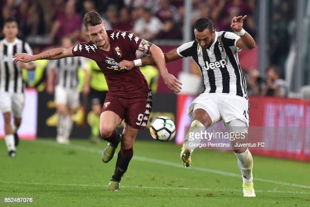 Medhi Benatia of Juventus and Andrea Belotti of Torino competes for the ball during the Serie A match between Juventus and Torino FC on September 23...