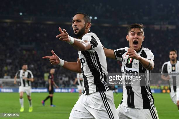 Medhi Benatia of Juventus FC celebrates after scoring the opening goal with team mate Paulo Dybala during the Serie A match between Juventus FC and...