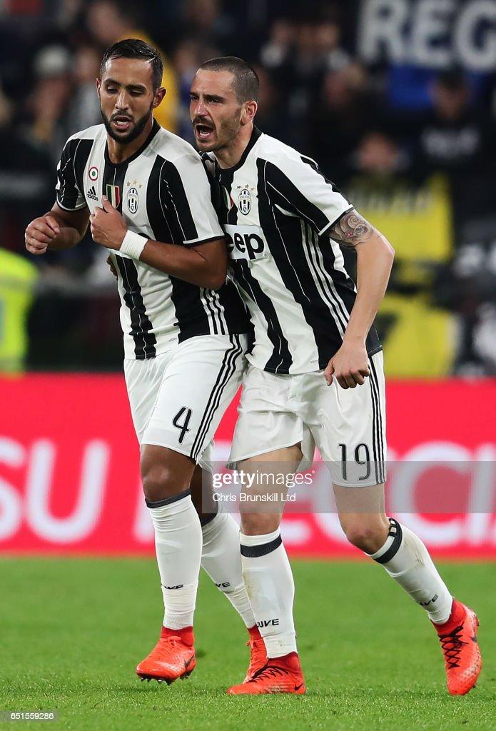 Medhi Benatia of Juventus FC (l) celebrates scoring the first goal to make the score 1-0 with Leonardo Bonucci during the Serie A match between Juventus FC and AC Milan at Juventus Stadium on March 10, 2017 in Turin, Italy.
