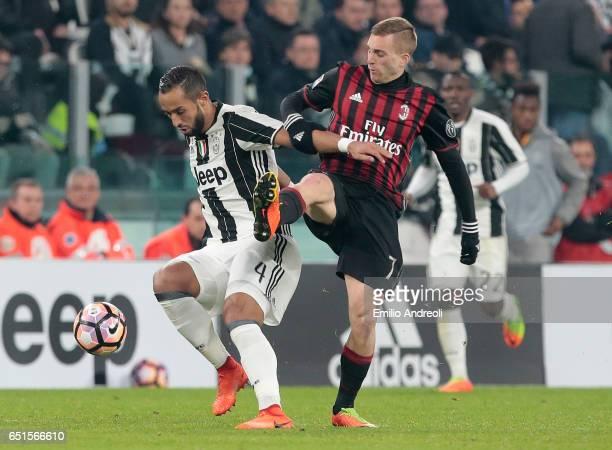 Medhi Benatia of Juventus FC competes for the ball with Gerard Deulofeu of AC Milan during the Serie A match between Juventus FC and AC Milan at...