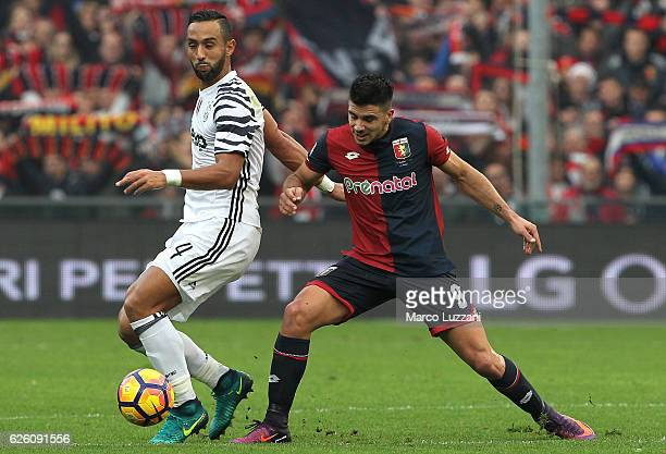 Medhi Benatia of Juventus FC competes for the ball with Giovanni Simeone of Genoa CFC during the Serie A match between Genoa CFC and Juventus FC at...