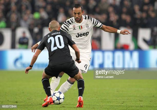 Medhi Benatia of Juventus FC is challenged by Andre Andre of FC Porto during the UEFA Champions League Round of 16 second leg match between Juventus...