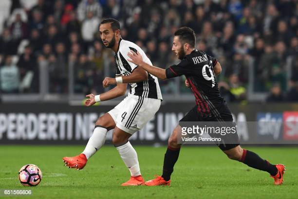 Medhi Benatia of Juventus FC is challenged by Andrea Bertolacci of AC Milan during the Serie A match between Juventus FC and AC Milan at Juventus...