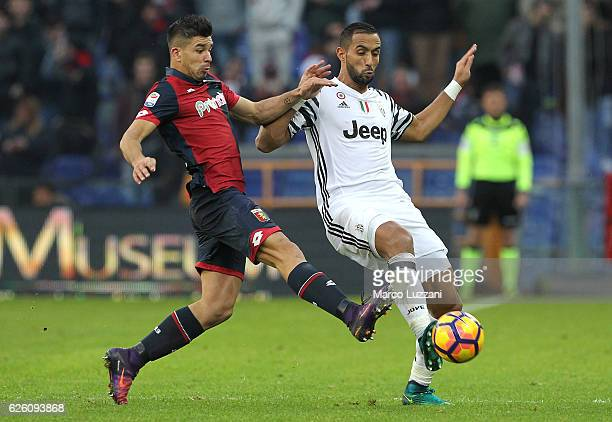 Medhi Benatia of Juventus FC is challenged by Giovanni Simeone of Genoa CFC during the Serie A match between Genoa CFC and Juventus FC at Stadio...