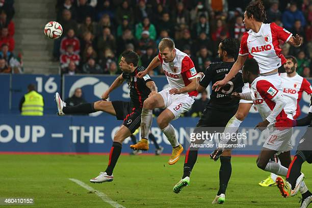 Medhi Benatia of Muenchen scores the opening goal during the Bundesliga match between FC Augsburg and FC Bayern Muenchen at SGL Arena on December 13...