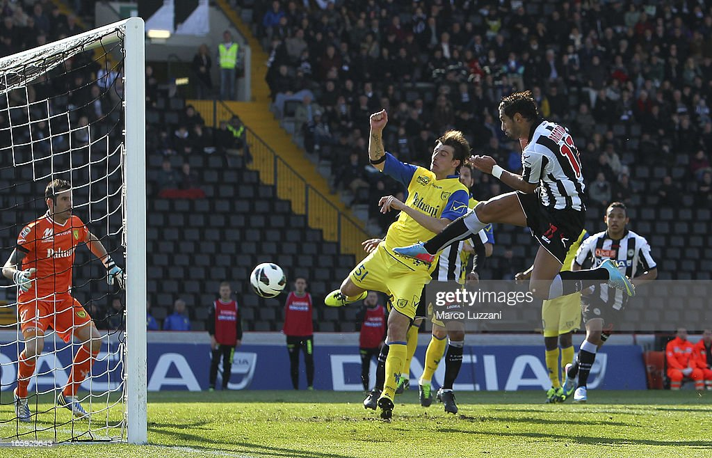 Medhi Benatia of Udinese Calcio scores their third goal during the Serie A match between Udinese Calcio and AC Chievo Verona at Stadio Friuli on...