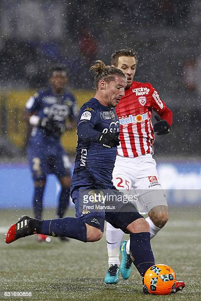 Medhi Mostefa of Bastia and Benoit Pedretti of Nancy during the Ligue 1 match between AS Nancy Lorraine and SC Bastia at Stade Marcel Picot on...