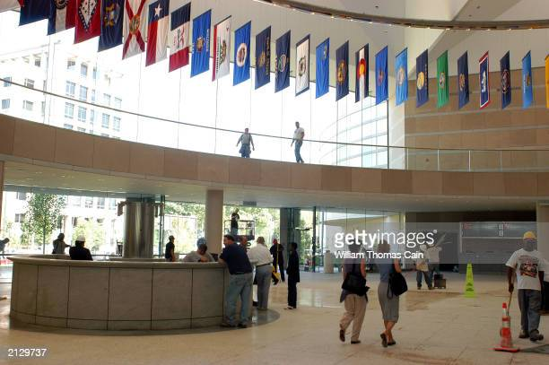 Media and construction workers walk through the Grand Hall during a preview of the National Constitution Center July 1 2003 in Philadelphia...