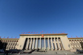 Media and other officials make their way in prior to the opening session of the 12th National People's Congress at the Great Hall of the People in...