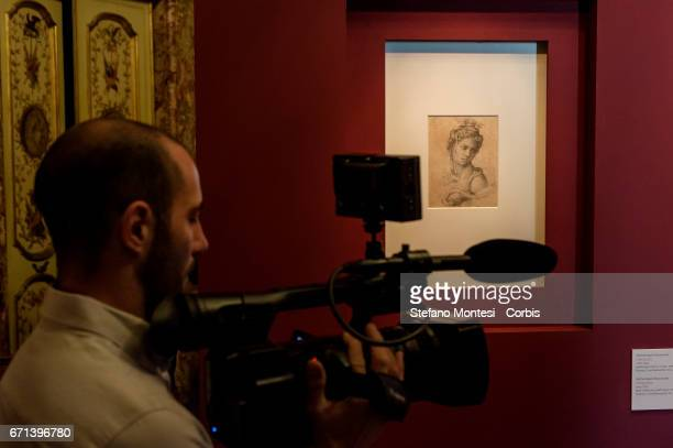 Media attend an exhibition opened to the public for the first time in which two newly found two drawings by Michelangelo 'The sacrifice of Isaac' and...