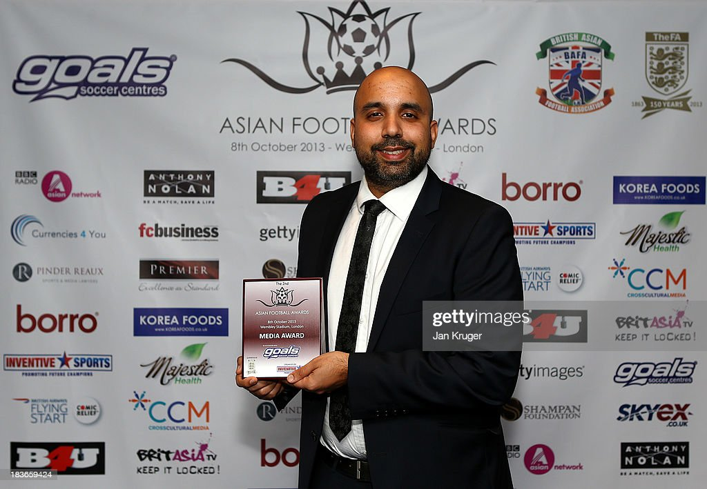 Media Award winner <a gi-track='captionPersonalityLinkClicked' href=/galleries/search?phrase=Amar+Singh&family=editorial&specificpeople=814034 ng-click='$event.stopPropagation()'>Amar Singh</a> poses during the Second Annual Asian Football Awards at Wembley Stadium on October 8, 2013 in London, England.